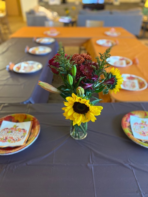 Thanksgiving table with flower centerpiece